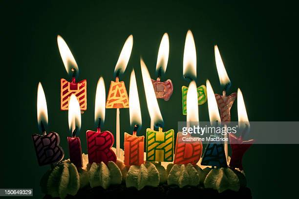 lit happy birthday candles - catherine macbride stock pictures, royalty-free photos & images