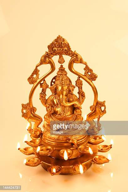 a lit idol of ganesh - ganesha stock photos and pictures