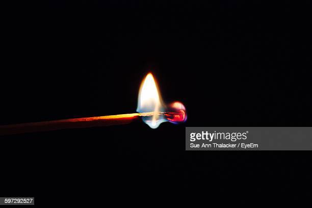 Lit Matchstick In Darkroom