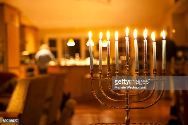 lit menorah in home - hanukkah stock photos and pictures