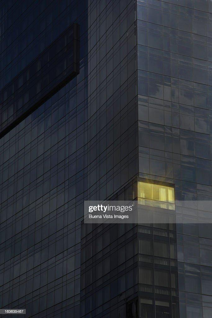 Lit office in a dark building : Bildbanksbilder