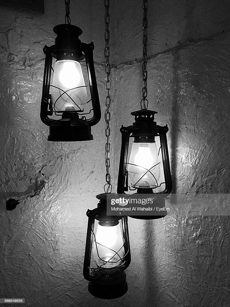 Lit Oil Lamps Against Wall : Stock Photo