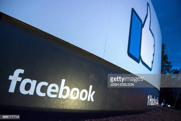 A lit sign is seen at the entrance to Facebook's corporate headquarters location in Menlo Park California on March 21 2018 Facebook chief Mark...
