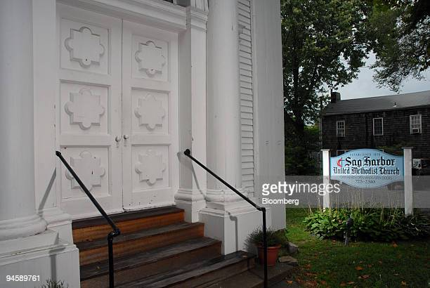 A lit sign sits outside the Sag Harbor Methodist Church on Madison Street in Sag Harbor Long Island New York US on Tuesday Sept 11 2007 Dennis...