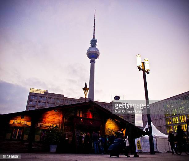 lit street light with communication tower against clear sky at dusk - german culture stock pictures, royalty-free photos & images