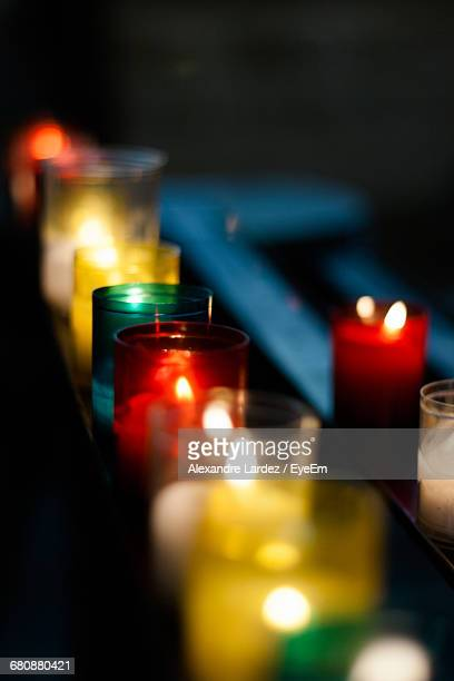 Lit Tea Light Candles On Table