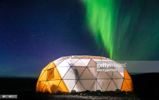 lit up dome tent, aurora borealis in background, narsaq, vestgronland, greenland - igloo stock pictures, royalty-free photos & images