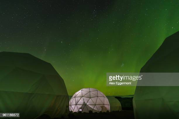 lit up dome tent, aurora borealis in background, narsaq, vestgronland, greenland - dome stock pictures, royalty-free photos & images