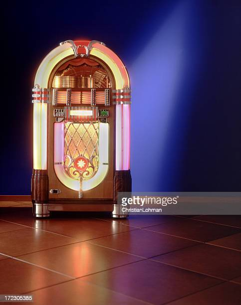 Lit up jukebox against a blue wall