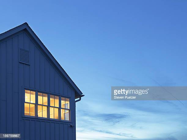 lit windows of home at dusk - dusk stock pictures, royalty-free photos & images