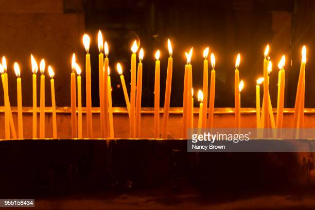 lite candles in church of the holy sepulchre. - stations of the cross stock pictures, royalty-free photos & images