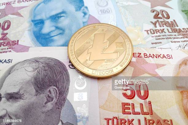litecoin on top of a stack of turkish lira - gwengoat stock pictures, royalty-free photos & images