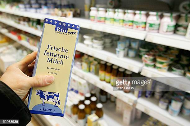 A liter of organic milk is seen among dairy products at a store of German organic supermarket chain EO Komma on March 2 2005 in Berlin Germany...
