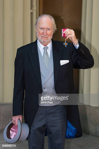 Literary agent Ed Victor poses after he received an CBE medal from the Prince of Wales for services to literature at an investiture ceremony at...