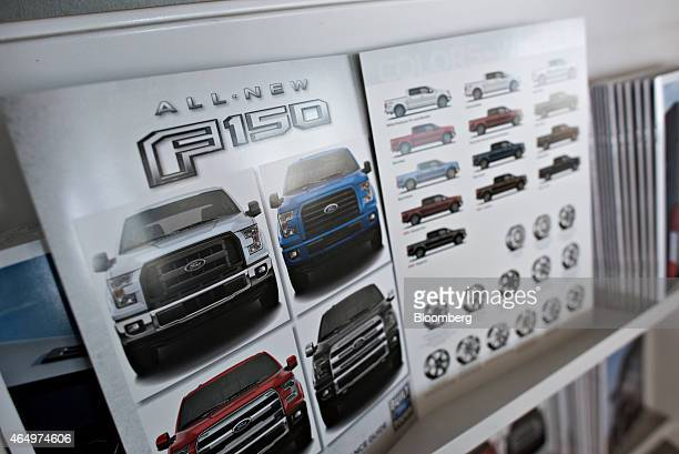 Literature for the new 2015 Ford Motor Co F150 pickup truck sits on display at Uftring Ford car dealership in East Peoria Illinois US on Monday March...