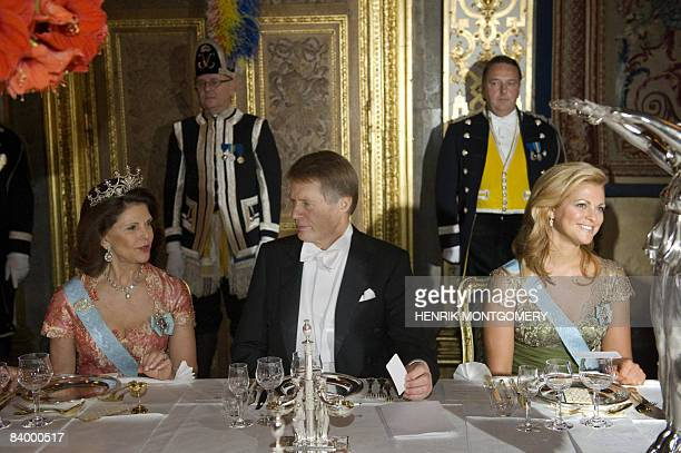 Literature Nobel Prize laureate French Jean-Mari Gustave Le Clezio sits between Swedish Queen Silvia and Princess Madeleine , during the gala dinner...