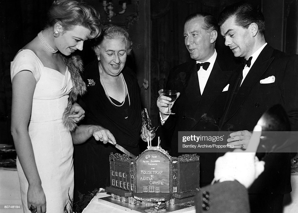 25th November 1958, English crime writer Agatha Christie cuts the cake watched by Mary Law, left, to mark the 6th anniversary of her play 'The Mousetrap', Agatha Christie,(1890-1976), the world's best known mystery writer, famous for her Hercule Poirot and Miss Marple stories, and for her plays including 'The Mousetrap'