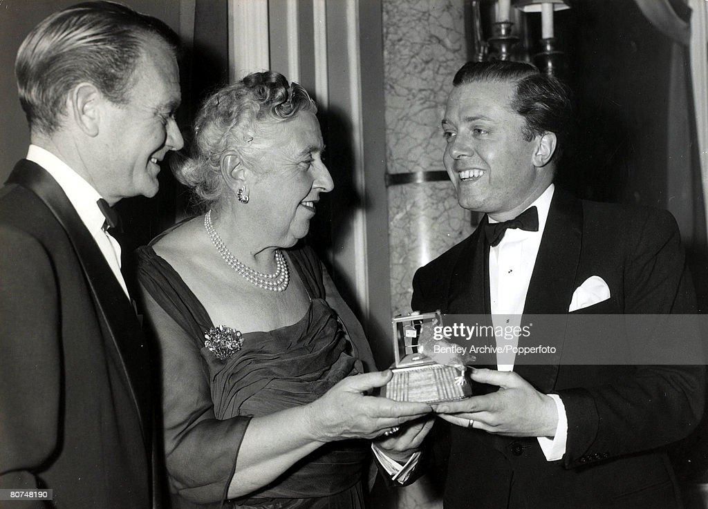 April 1958, English crime writer Agatha Christie is presented with a mousetrap by actors Richard Attenborough, right and John Mills in honour of her long running play, Agatha Christie,(1890-1976), the world's best known mystery writer, famous for her Hercule Poirot and Miss Marple stories, and for her plays including 'The Mousetrap'