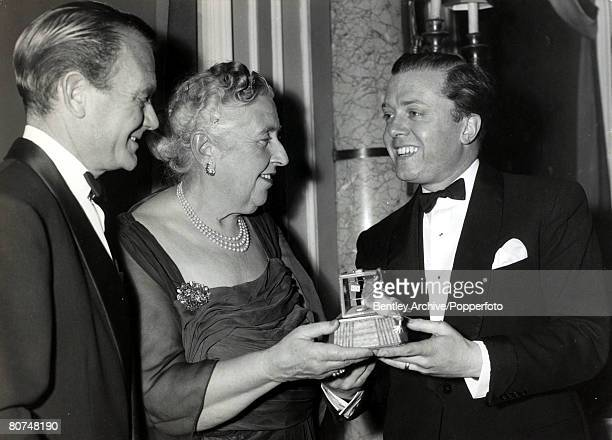 April 1958 English crime writer Agatha Christie is presented with a mousetrap by actors Richard Attenborough right and John Mills in honour of her...