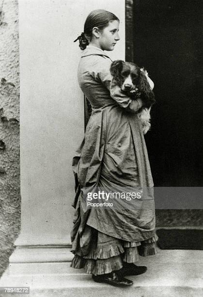 circa 1880 English author Beatrix Potter as a girl with one of her dogs Beatrix Potter an author and illustrator of children's books was one of the...