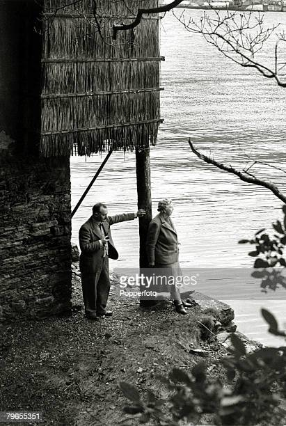 January 1946 English crime writer Agatha Christie pictured with her husband Prof Max Mallowan outside the boathouse near their home Greenway House...