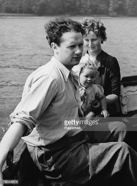 Literature Welsh poet Dylan Thomas enjoys a boat trip with his wife Caitlin and baby daughter Aeronwy on the River Taff Laugharne South Wales 1943