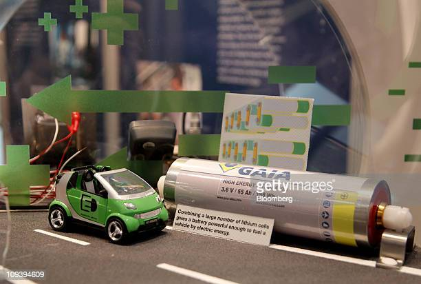 SE lithium cell battery sits on display alongside a model car during a news conference in Ludwigshafen Germany on Thursday Feb 24 2011 BASF SE the...