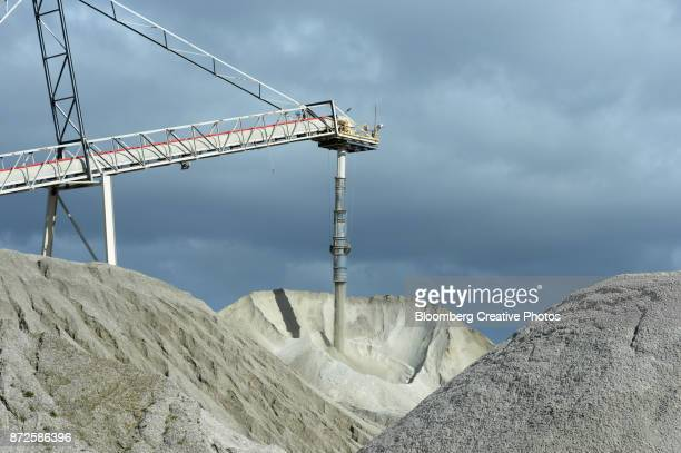 Lithium ore falls from a chute onto a stockpile