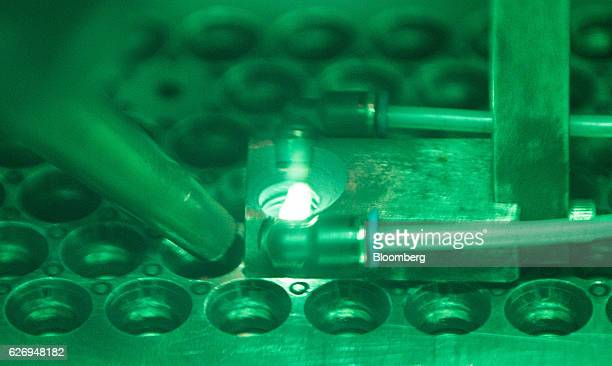 A lithiumion battery cell is welded into a block as seen through a magnifying lens at the Johammer emobility GmbH electric motorbike factory in Bad...