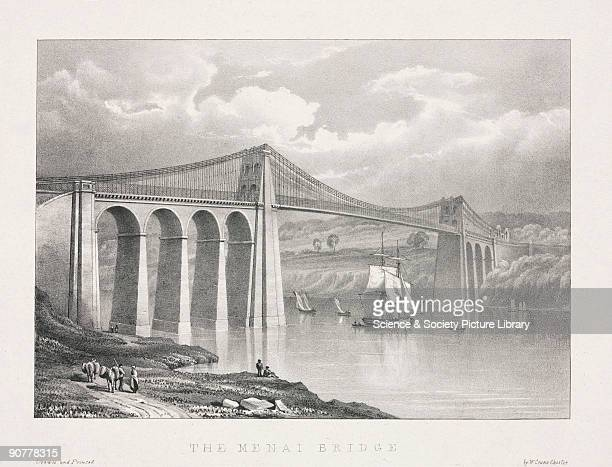 Lithograph drawn and lithographed by W Crane The suspension road bridge connecting the Welsh mainland with Anglesey across the Menai Straits was...
