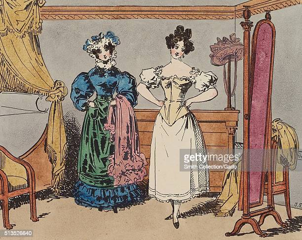 A lithograph of a woman examining her image in a mirror after being corseted the is being complimented on the elegance of her waistline by the woman...