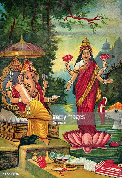 A lithograph of Hindu deities Ganesha the god of wisdom prudence and learning is shown as well as Lakshmi with spouse of Vishnu and symbol of...