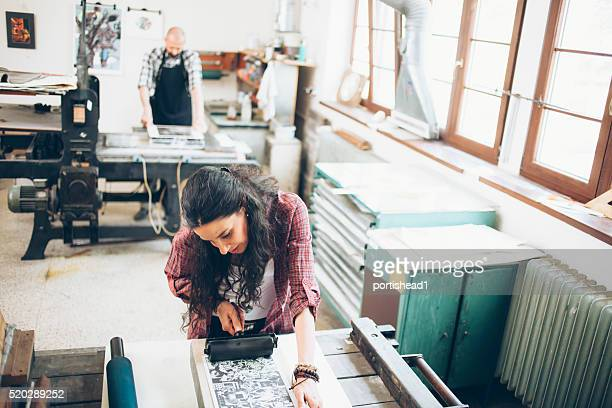 lithography workers handmaking at workshop - lithograph stock pictures, royalty-free photos & images