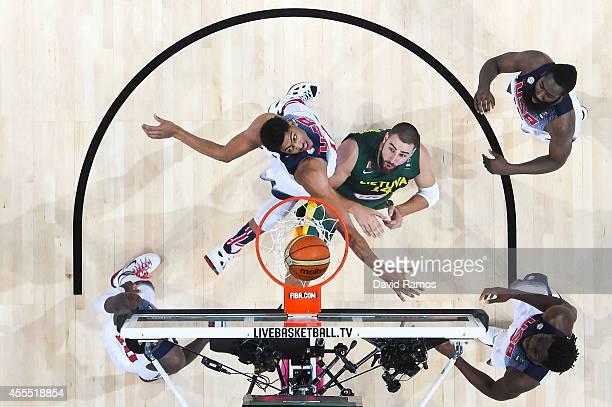Lithuania Basketball Men's National and USA Basketball Men's National Team players duel for the ball during a 2014 FIBA Basketball World Cup...