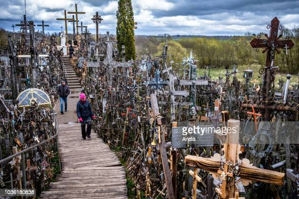 the Hill of Crosses The Hill of Crosses a pilgrimage site symbol of Lithuanian defiance of foreign invaders with over 100000 crosses and statues dug...