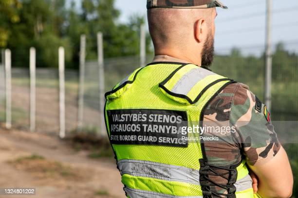 Lithuania State Border guard Vytautas Makauskas patrols near the Lithuania-Belarus border line on June 21, 2021 near Poskonys, Lithuania. The...