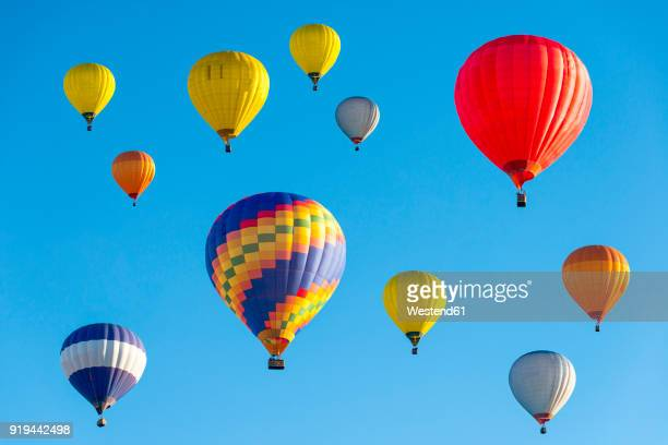 lithuania, vilnius, hot air balloons - balloon ride stock pictures, royalty-free photos & images