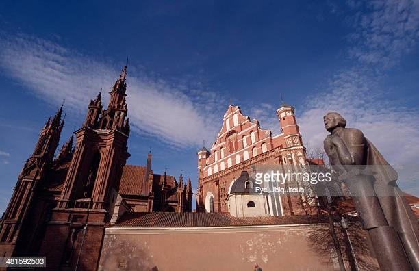 Lithuania Vilnius Saint Francis and Bernardine Church behind the Adam Mickiewicz statue