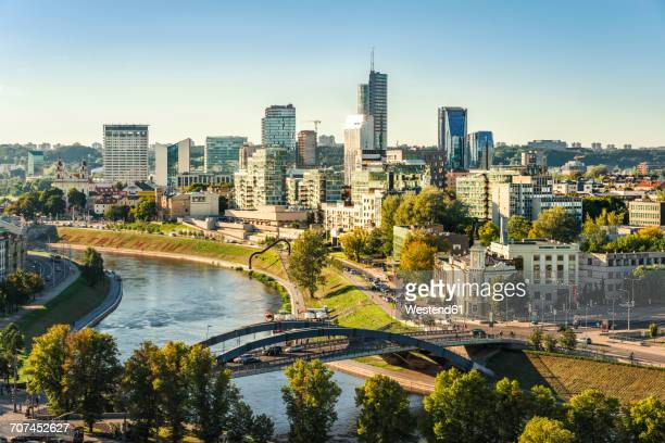 lithuania, vilnius, view to the modern city of vilnius with europa tower and neris river in the foreground - capital cities stock pictures, royalty-free photos & images