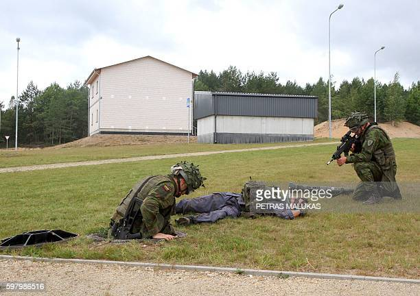 Lithuanian army soldiers take part in an exercise following the official opening of a military training centre for urban warfare in Pabrade Lithuania...