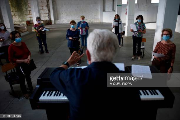 Lithuanian choir director Rimas Zdanavicus gives instructions to the Apostol Santiago choir's members during their first rehearsal after the...
