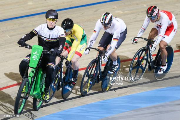 Lithuanian cyclist Vasilijus Lendel Germany's Maximilian Levy and Japanese's Yuta Wakimoto compete in the first round of the men's Keirin during the...