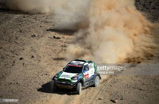 Lithuanian driver Vaidotas Zala and codriver Lithuanian Saulius Jurgelenas compete during the Stage 2 of the Dakar 2020 between Al Wajh and Neom...