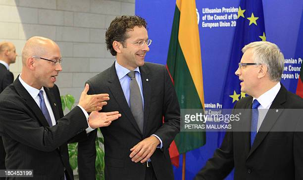 Lithuanian Finance Minister Rimantas Sadzius welcomes Joerg Asmussen member of the executive board of the European Central Bank and Jeroen...