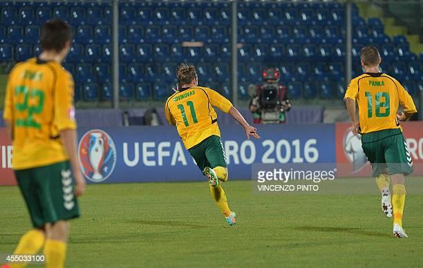 Lithuanian midfielder Arvydas Novikovas celebrates after scores against San Marino during the UEFA Euro 2016 Group E qualifying match of San Marino...