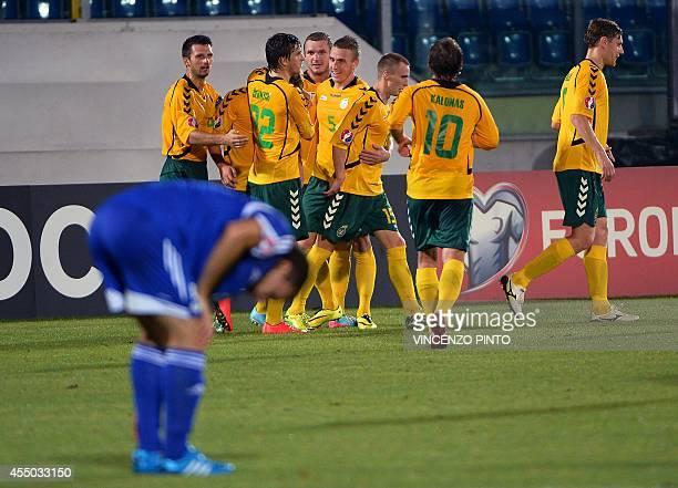 Lithuanian midfielder Arvydas Novikovas celebrates with teammates after scores against San Marino during the UEFA Euro 2016 Group E qualifying match...