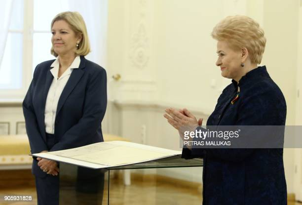 Lithuanian President Dalia Grybauskaite and the German ambassador to Lithuania Angelika Viets stand next to the historic document called Lithuania's...