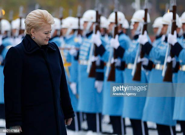 Lithuanian President Dalia Grybauskaite and Turkish President Recep Tayyip Erdogan walk past a guard of honor during an official welcoming ceremony...