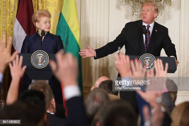 Lithuanian President Dalia Grybauskaite and U.S. President Donald Trump hold a joint news conference in the East Room of the White House April 3,...