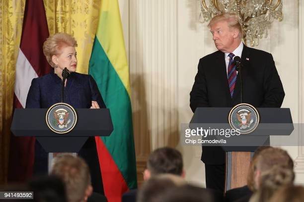Lithuanian President Dalia Grybauskaite and US President Donald Trump hold a joint news conference with fellow Baltic leaders in the East Room of the...